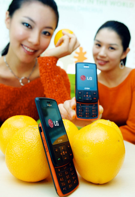 LG orange phone, or a phone and some oranges
